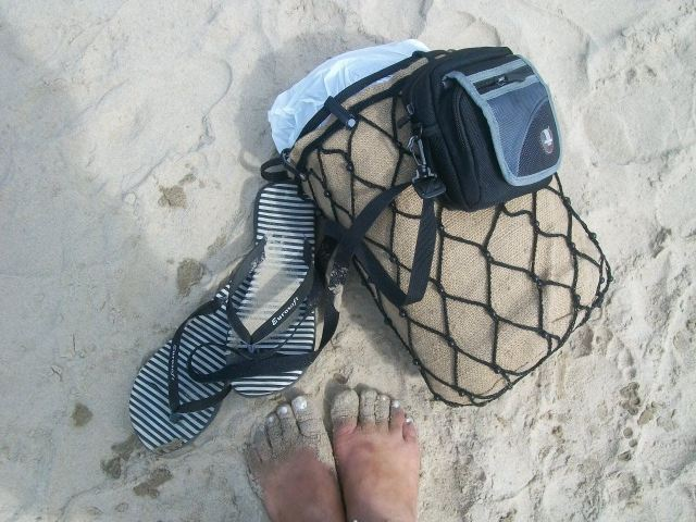 Happy feet, soaked in the sand at Paradise beach