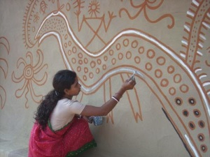 A woman creating art murals